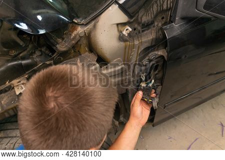 Specialist In Repairing The Electrical Wiring Of A Car Solves A Problem With Chips, Wires