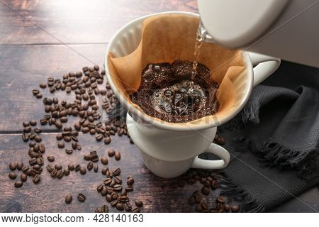 Brewed Coffee, Pouring Hot Water On Ground Coffee In A Filter On A Mug For A Stimulating Drink, Rust