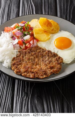 Silpancho Is A Popular Bolivian Food It Consists Of A Base Layer Of Rice, Sliced Potatoes, Pounded F