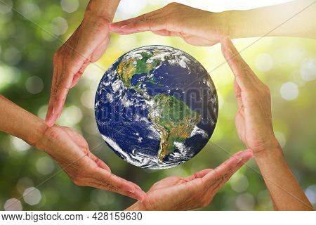 Hands Holding Planet Earth On Blurred Green Nature With Sunlight Background, Elements Of This Image