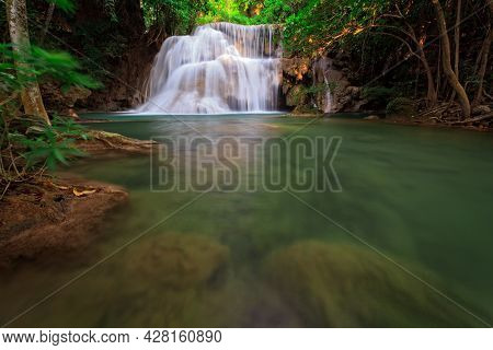 Waterfall In Green Tropical Forest, Western Thailand