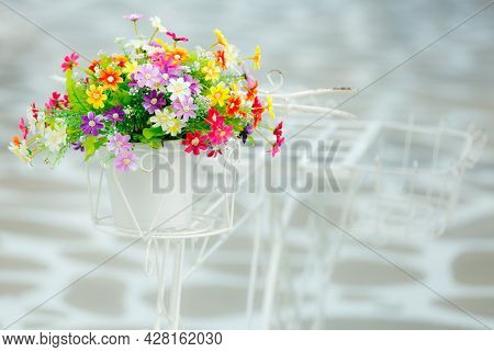 Colorful Artificial Flowers Made From Fabric On Fake Bicycle.
