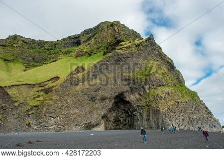 Vik, Iceland - May 21, 2019: Tourists Visiting The Reynisfjara Beach And The Basalt Columns On The A