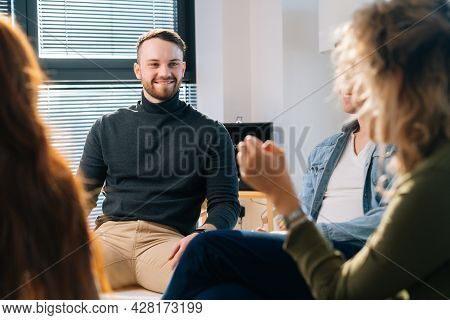Successful Male Trainer Conduct Corporate Training With Creative Business Team Sitting In Circle On