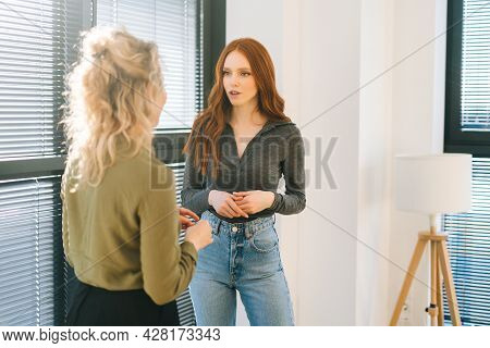 Back View Of Young Redhead Businesswoman Discuss Project Have Business Conversation In Corporate Wor