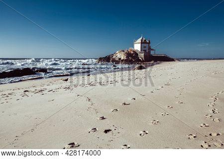 Chapel Senhor da Pedra on Praia de Miramar, Vila Nova de Gaia, Portugal.