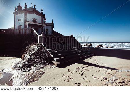 View of Chapel Senhor da Pedra on Praia de Miramar, Vila Nova de Gaia, Portugal.