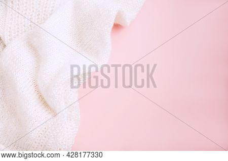 White Knitted Fabric On Pink Background. Craft On Black Background. Knitwear As A Concept Of Female