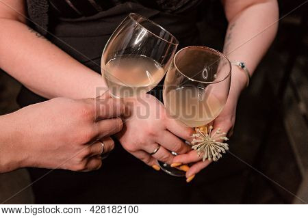 A Glass Clinks With A Glass Of Fruit Cider In The Hands Of A Girl