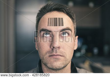A Man With A Stupid Expression Looks At His Qr Code On His Head. The Concept Of Chipping The Populat