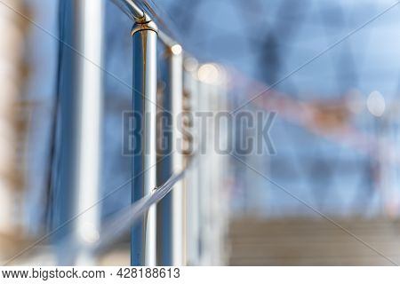 Fence, Stair Railing, Metal, Round, Hold, Go, Up, Day, Sun, Background Is Very Blurred, Abstraction