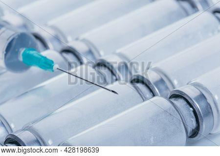 Medicine, Injection, Vaccine And Disposable Syringe, Drug Concept. Sterile Vial Medical Syringe Need