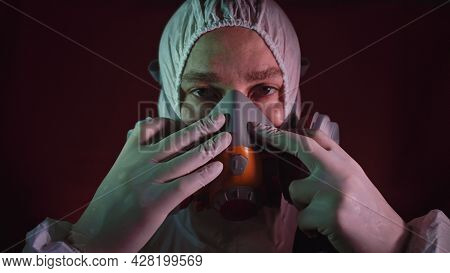 Man In Protective Costume Suit, Gas Protect Medical Spray Paint Mask. Doctor In Respirator. Concept
