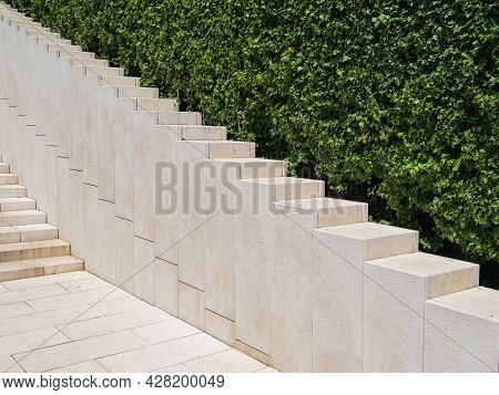Ornamental Garden With Trimmed Bushes And Beige Staircase. Geometrical Background With Shrubs And Ar