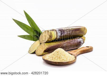 Wooden Spoon With Unrefined Raw Cane Sugar, Demerara Sugar, With Sugar Cane, Isolated White Backgrou