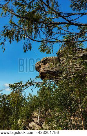 Stone City, Perm Region, Russia. Turtle Rock. Natural Landscape Landmark Reserve Park On Blue Sky Ba