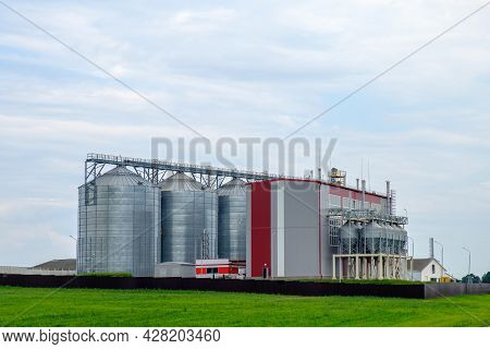 Agribusiness Concept. Agro-processing And Manufacturing Plant With Metal Silos For Grain Storage, Dr