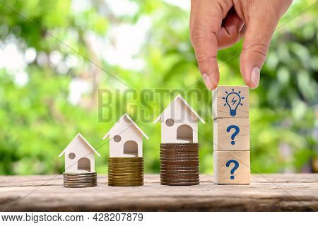 House Model On Money And Investor Hand Holding Wooden Block With Light Bulb Icon Money Growing Conce