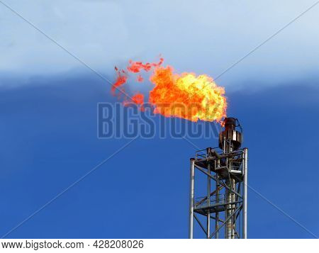 Gas Flare Is Releasing And Burning To The Atmosphere At An Offshore Gas Platform With Sky. Fire On A