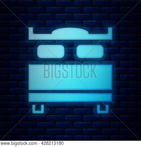 Glowing Neon Bedroom Icon Isolated On Brick Wall Background. Wedding, Love, Marriage Symbol. Bedroom