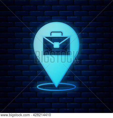 Glowing Neon Online Working Icon Isolated On Brick Wall Background. Freelancer Man Working On Laptop