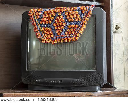 The Old Picture Tube Tv Is Covered With A Cape.