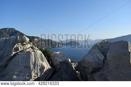 Landscape With Rocks At The Forefront With A Corrugated Surface Of Unknown Genesis.