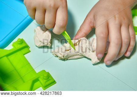 Child Is Sculpting With Modeling Clay. Art Activity For Children, Indoor Fun For Kids Concept. Close