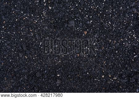 Natural Fiery Ash With A Black Texture Of Black Coals. Wood Soot Background And Texture. Place For Y