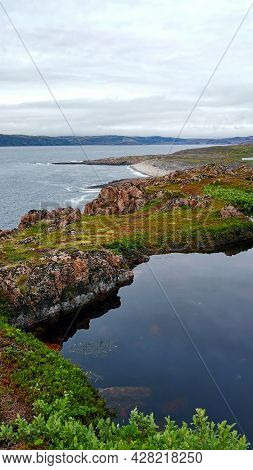 Tundra And Blue Lake On Background Mountain Picks In Cloudy Weather In Polar Summer. Arctic Landscap