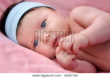 Adorable Baby Newborn With Blue Eyes