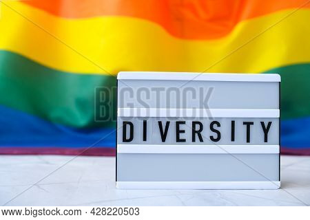 Rainbow Flag With Lightbox And Text Diversity. Rainbow Lgbtq Flag Made From Silk Material. Symbol Of