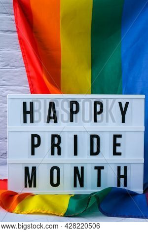 Rainbow Flag With Lightbox And Text Happy Pride Month. Rainbow Lgbtq Flag Made From Silk Material. S