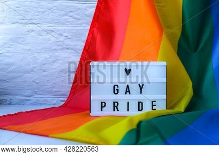 Rainbow Flag With Lightbox And Text Gay Pride. Rainbow Lgbtq Flag Made From Silk Material. Symbol Of