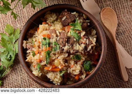 Fried And Stewed Beef Meat With Rice. Uzbek Cuisine  Pilaf (plov)