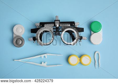 Different Ophthalmologist Tools On Light Blue Background, Flat Lay