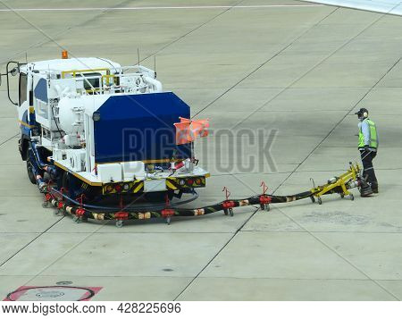 Refuel Truck For Airplane Parked And Waiting Refuel The Airplane On Ground In The Airport. Ground Te