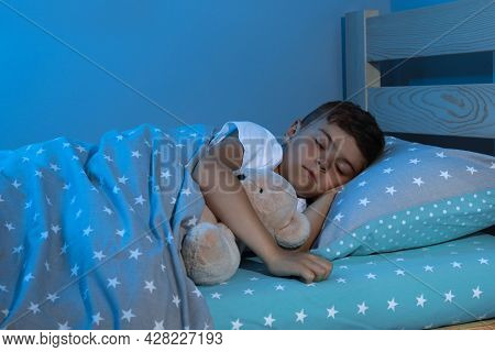 Cute Little Boy Sleeping With Teddy Bear At Home. Bedtime