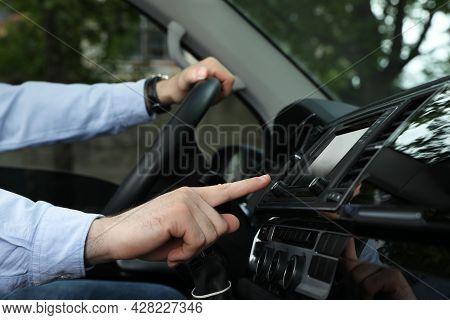 Driver Using Modern Car Navigation System, Closeup