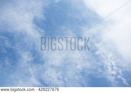 Blue Bright Sky With White Clouds. Heaven Background. Beautiful White Clouds In The Sky