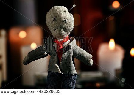 Voodoo Doll Pierced With Pins In Dark Room, Closeup. Curse Ceremony