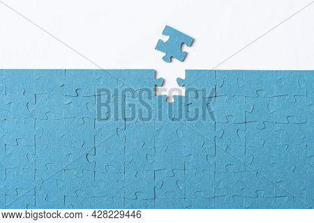 Last Piece Of Puzzle Lying Separately On White Background. The Puzzle Is Assembled