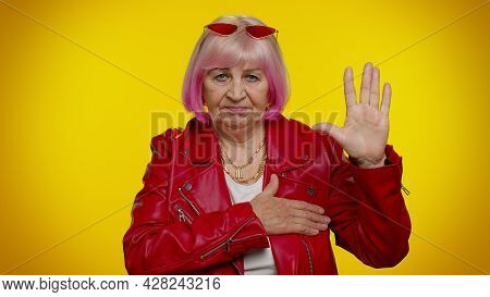 I Swear To Be Honest. Sincere Responsible Senior Old Granny Gray-haired Woman Raising Hand To Take O