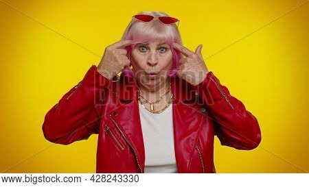 You Are Crazy, Out Of Mind. Senior Old Woman Rocker Pointing At Camera And Showing Stupid Gesture, B