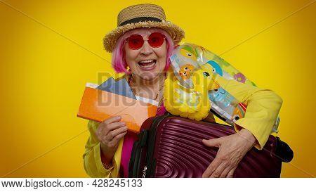 Traveler Tourist Senior Woman Granny Celebrating, Holding Passport, Tickets, Luggage. Concept Summer