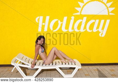 Sexy Girl With Wet Hair. Lady In Swimming Suit. Summer Resort With Beach Chaise Lounge. Relax On Sun