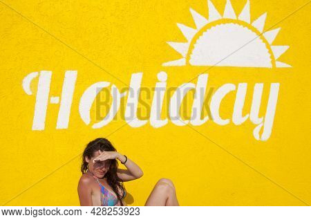 Relax And Sunbathe. Cheerful Woman On Yellow Background. Summer Vacation And Holiday. Holiday Text O