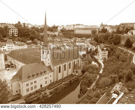 Lower Town Of Luxembourg City And The Neumunster Abbey, The Grand Duchy Of Luxembourg In Sepia Color