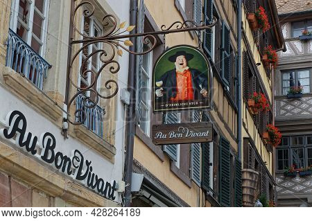 Strasbourg, France, June 23, 2021 : Ensign Of A Restaurant In A Small Street Of Strasbourg Touristic
