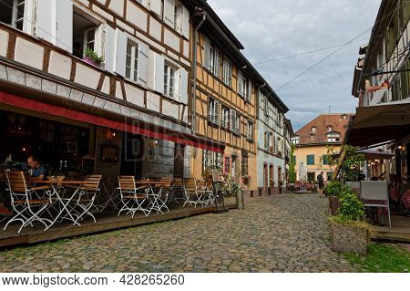 Strasbourg, France, June 23, 2021 : A Touristic Street In Petite France Quarter, Home In The Middle